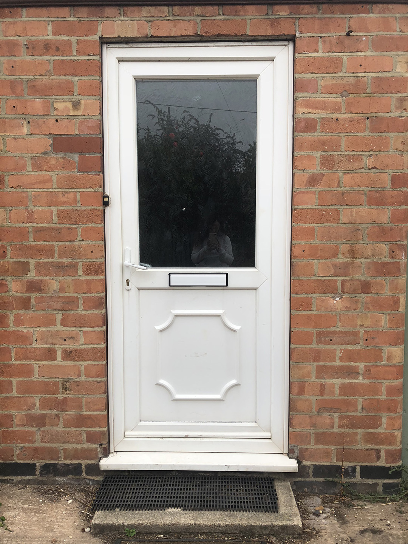 Grey & Gold Composite Door with wreath