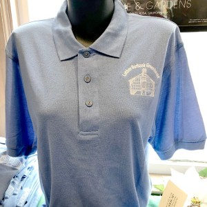 Blue polo shirt with embroidered greenhouse