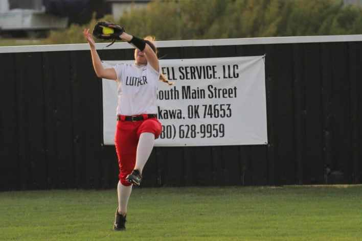 Lions Softball, Whittaker catches a fly in right field.