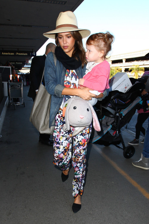 Jessica Alba and daughter Haven arrive at LAX in multi styled outfit