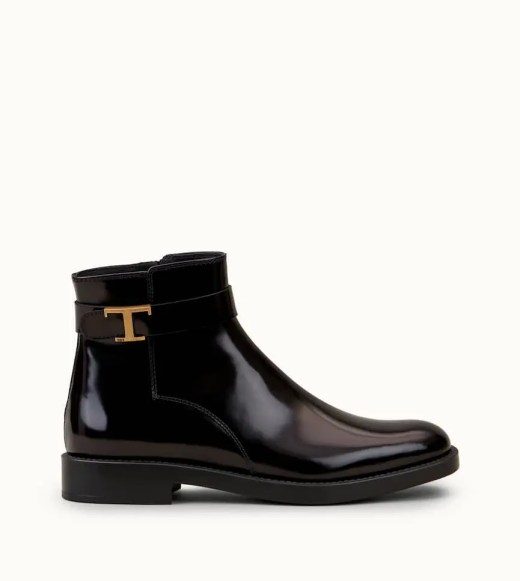 Polished leather ankle boots featuring gold-tone metal T Timeless detail, side zipper and rubber sole with embossed pebbles.