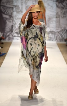 A model walks the runway at the Agua Bendita show with TRESemme during Mercedes-Benz Fashion Week Swim 2014 at the Raleigh on July 19, 2013 in Miami, Florida.