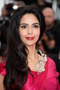 """CANNES, FRANCE - MAY 14:  Mallika Sherawat attends the """"Mad Max : Fury Road""""  Premiere during the 68th annual Cannes Film Festival on May 14, 2015 in Cannes, France.  (Photo by Venturelli/WireImage)"""