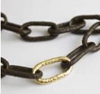 Collier, maillons acier, un maillon d'or 4800€