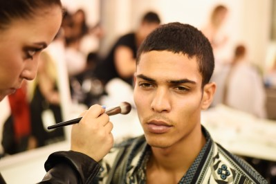 PARIS, FRANCE - SEPTEMBER 28: A model has makeup applied backstage during FENTY x PUMA by Rihanna at Hotel Salomon de Rothschild on September 28, 2016 in Paris, France. (Photo by Victor Boyko/Getty Images for Fenty x Puma)