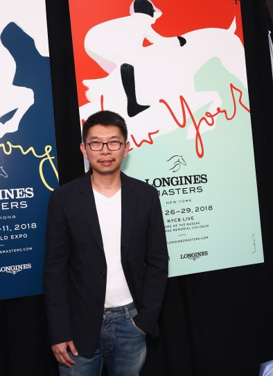 NEW YORK, NY - MAY 17: Artist Sirichai poses with posters at the Longines Masters launch party celebrating Series' epic move to New York at Salon de Ning on May 17, 2017 in New York City. (Photo by Astrid Stawiarz/Getty Images for Longines)
