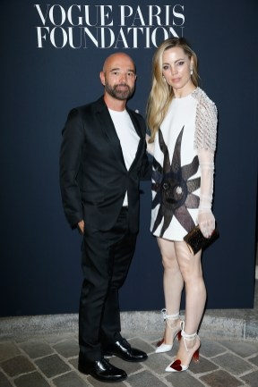 PARIS, FRANCE - JULY 04: (R) Melissa George and guest attend the Vogue Foundation Dinner during Paris Fashion Week as part of Haute Couture Fall/Winter 2017-2018 at Musee Galliera on July 4, 2017 in Paris, France. (Photo by Julien Hekimian/Getty Images for Vogue) *** Local Caption *** Melissa George