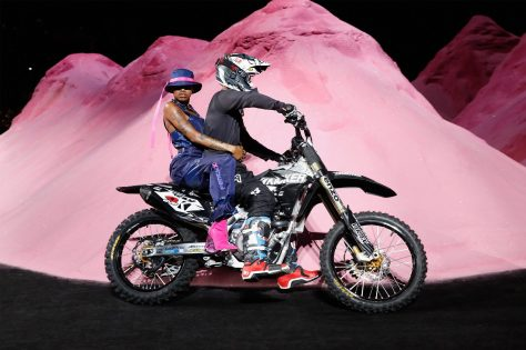 NEW YORK, NY - SEPTEMBER 10: A model rides on the back of a dirtbike around the runway at the FENTY PUMA by Rihanna Spring/Summer 2018 Collection at Park Avenue Armory on September 10, 2017 in New York City. (Photo by Brian Ach/Getty Images for FENTY PUMA By Rihanna)