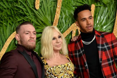 LONDON, ENGLAND - DECEMBER 04: MMA Fighter Conor McGregor, designer Donatella Versace and F1 driver Lewis Hamilton attend The Fashion Awards 2017 in partnership with Swarovski at Royal Albert Hall on December 4, 2017 in London, England. (Photo by Jeff Spicer/BFC/Getty Images)