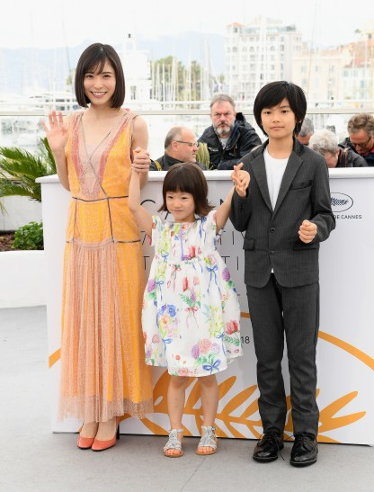 """CANNES, FRANCE - MAY 14: (L-R) Mayu Matsuoka, Miyu Sasaki and Jyo Kairi attend the photocall for """"Shoplifters (Manbiki Kazoku)"""" during the 71st annual Cannes Film Festival at Palais des Festivals on May 14, 2018 in Cannes, France. (Photo by Emma McIntyre/Getty Images)"""