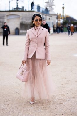 PARIS, FRANCE - FEBRUARY 25: Liza Koshy, wearing a pink blazer, pink shirt, pink tulle maxi skirt, Dior bag and Dior heels, is seen outside Dior, during Paris Fashion Week - Womenswear Fall/Winter 2020/2021 : Day Two on February 25, 2020 in Paris, France. (Photo by Claudio Lavenia/Getty Images)