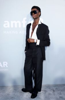 ALTON MASON IS DRESSED BY DIOR HE WORE A BLACK WOOL PEAK LAPEL TUXEDO, A CLASSIC WHITE COTTON SHIRT, A BLACK WOOL TUXEDO BELT AND A PAIR OF BLACK LEATHER DERBIES WITH SADDLE DETAIL CAP D'ANTIBES, FRANCE - JULY 16: Alton Mason attends the amfAR Cannes Gala 2021 at Villa Eilenroc on July 16, 2021 in Cap d'Antibes, France. (Photo by Andreas Rentz/amfAR/Getty Images for amfAR)