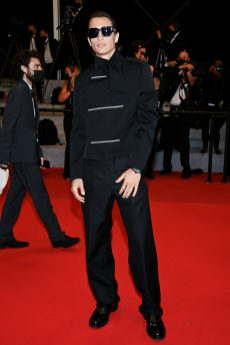 JAMES TURLINGTON IS DRESSED BY DIOR HE WORE A BLACK MOHAIR WOOL OFFICER SUIT, A CLASSIC BLACK COTTON SHIRT, A BLACK SILK BOW-TIE AND A PAIR OF BLACK LEATHER DERBIES