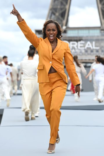 """PARIS, FRANCE - OCTOBER 03: Aja Naomi King walks the runway during """"Le Defile L'Oreal Paris 2021"""" as part of Paris Fashion Week on October 03, 2021 in Paris, France. (Photo by Pascal Le Segretain/Getty Images For L'Oreal)"""