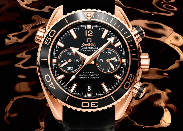 The Omega Seamaster Planet Ocean Ceragold wrist watches with ceramic bezel.