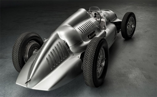In 1934, Auto Union and Mercedes-Benz appeared on the international motor racing scene with German racing cars of totally new design, with a silver finish and futuristic appearance, and were immediately successful. Whereas Mercedes-Benz relied on conventional front-engined cars, Auto Union placed the engine behind the driver – the layout that is still a standard feature of today's Formula One cars. The two manufacturers dominated racing on Europe's Grand Prix circuits without serious opposition until the outbreak of the Second World War in 1939.