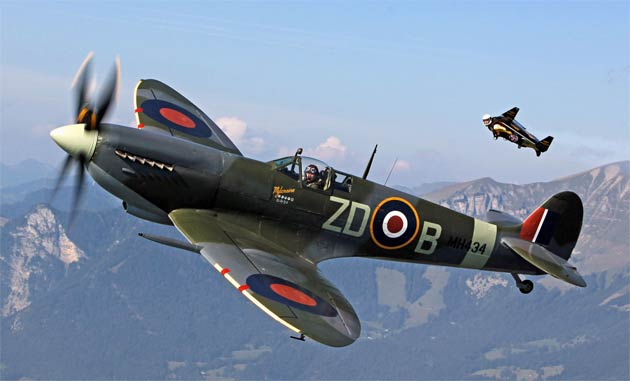 """As part of a celebration of Aviation, Yves """"Jetman"""" Rossy took to the skies with fellow """"Breitling Flyer"""" pilot, Nigel Lamb in the renowned Spitfire MH434."""