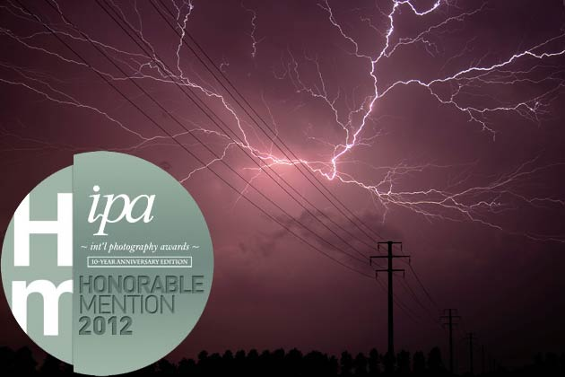 "Honorable Mention in Fine Art - Landscape category for the winning entry ""Electric Activities."""
