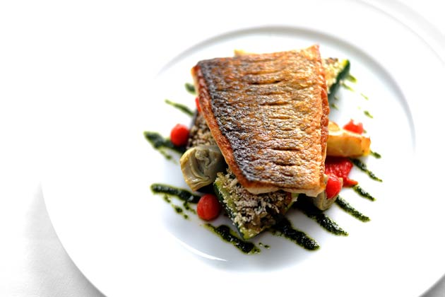 Griddled South Coast sea bass with provencal vegetables and basil oil