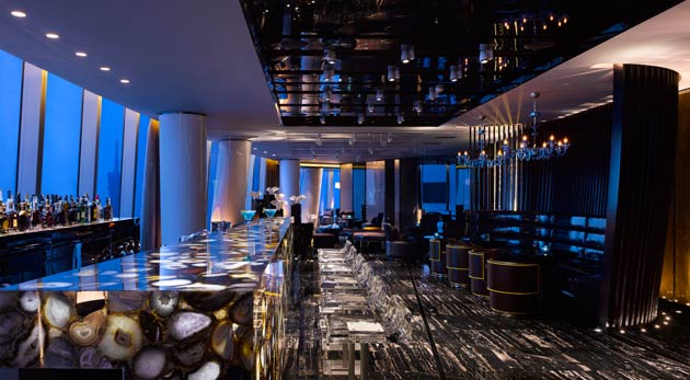 Nowhere is the sense of height more intense than from the 100th floor restaurant and 99th floor bar and Executive Club lounge, with a staircase that is cantilevered over the atrium connecting the two levels. Throughout the hotel, a carefully curated collection of paintings, prints, and sculptures by contemporary international artists enhance HBA's sleek modern interiors and Wilkinson Eyre's dramatic architecture.