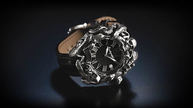 The case is complemented by a leather strap with contrasting edges, terminating in a buckle with the skull motif, while the dial features applied Roman numerals, suggesting the antiquity of the Middle Ages.