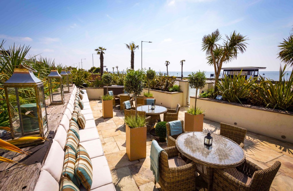 The terrace at Roslin Beach Hotel overlooking the beach