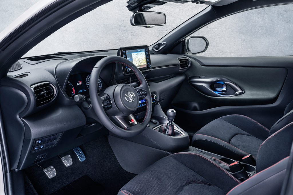 Toyota GR Yaris interior showing dashboard sterring wheel and gear stick