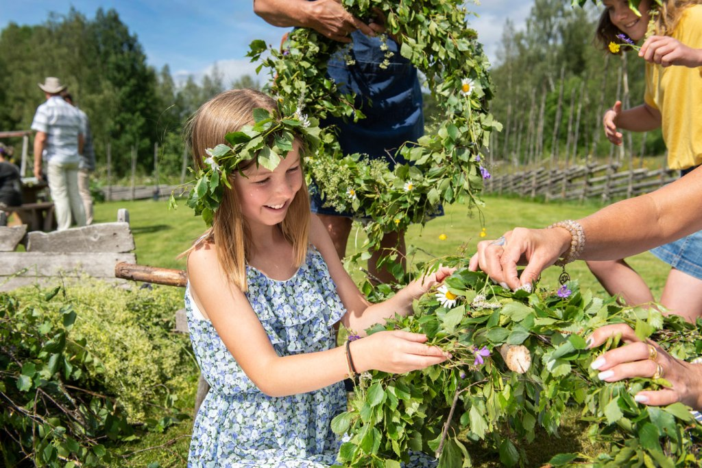 Making floral wreath for Swedish Midsummer