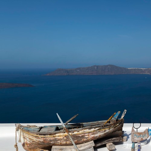 Old rowboat on a roof terrace overlooking the caldera in Fira on the island of Santorini, Cyclades, Greece.