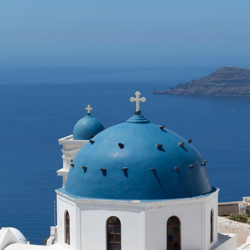 Blue church domes in Thira on the Island of Santorini, Cyclades, Greece.