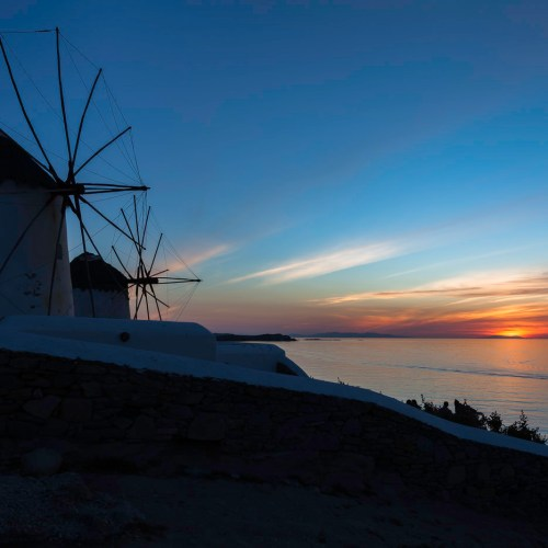The famous Chora windmills at sunset. Mykonos, Cyclades, Greece.