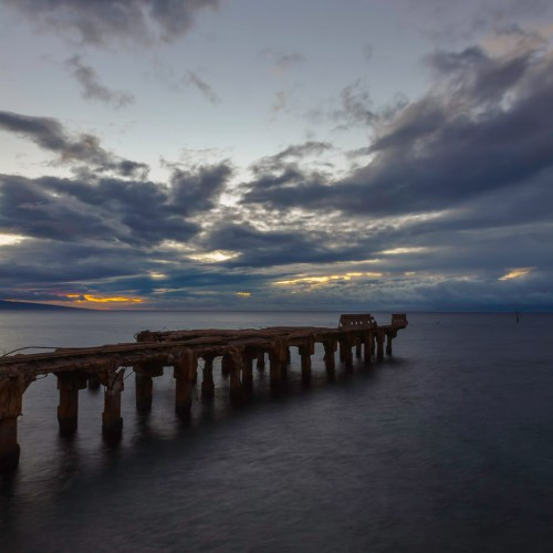 Sunset view of an old concrete pier remains in Lahaina, Maui, Hawaii, USA.