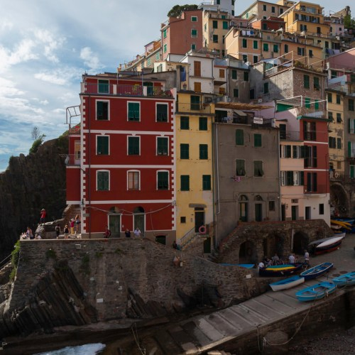 A boat ramp under the colorful houses of Riomaggiore in Cinque Terre National Park (Parco Nazionale delle Cinque Terre), Italy.