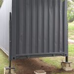 After the adjustable supports of the shipping container is painted and fitted.