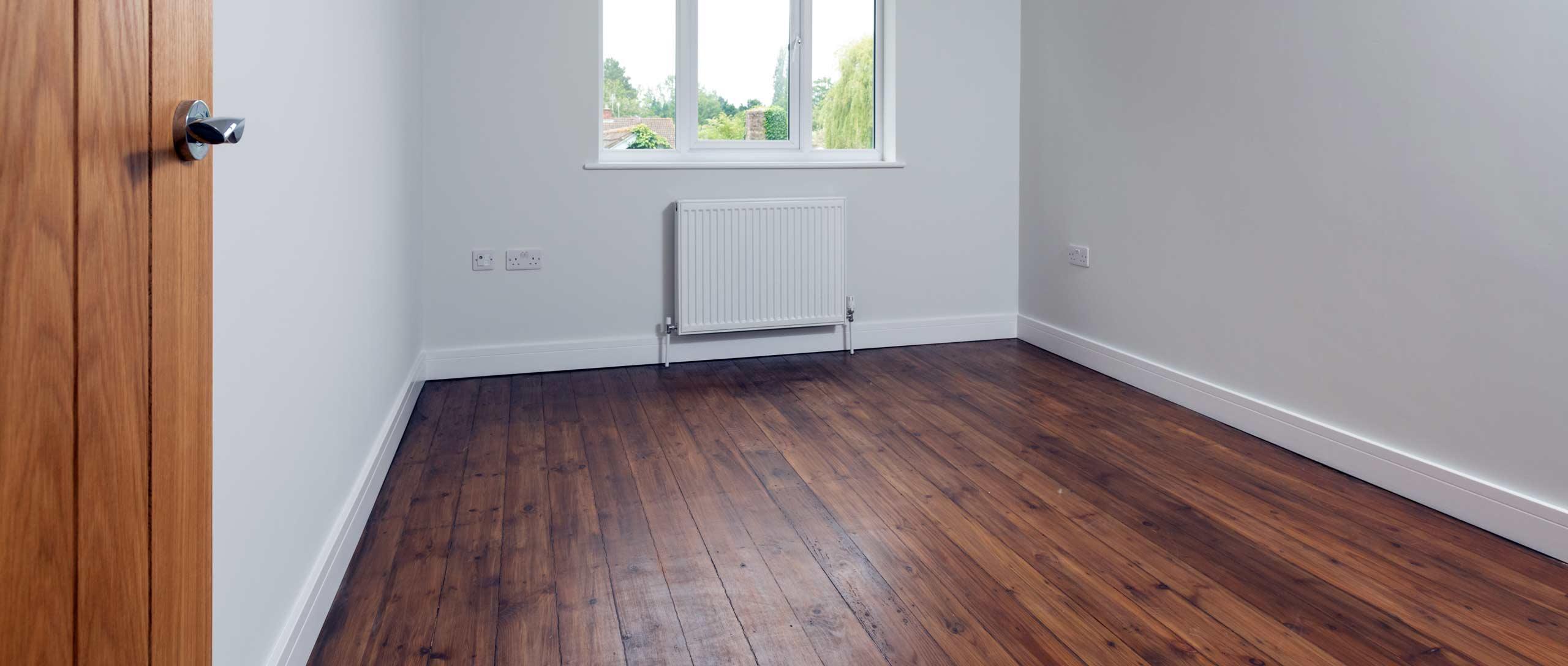 New hardwood floor in empty bedroom