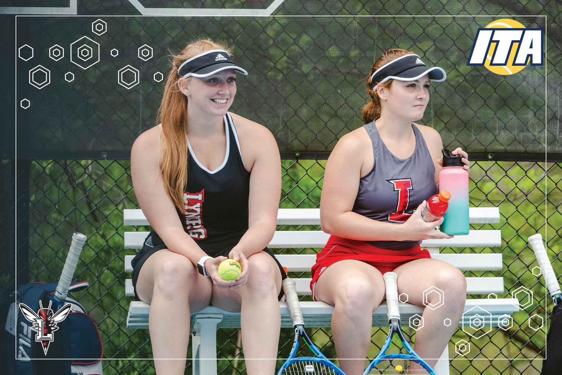 Tennis players rest on a bench between sets