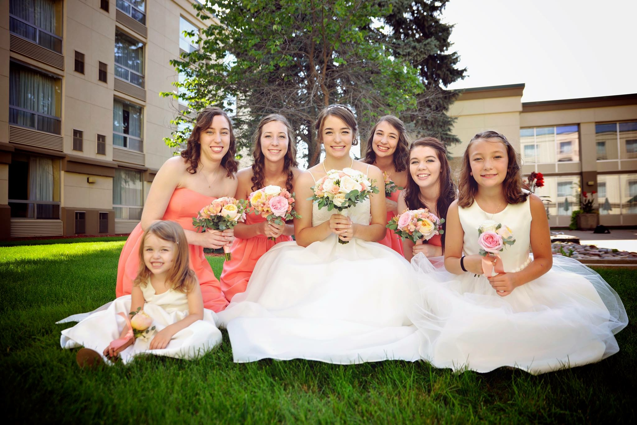 women-and-girls-posing-with-wedding-flowers