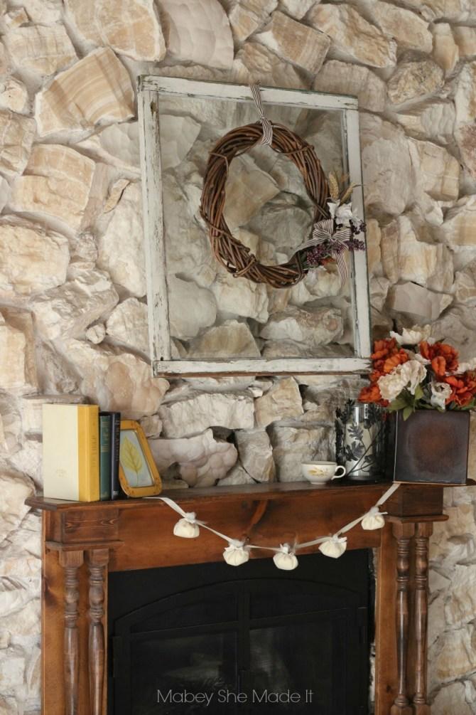 Rustic Fall Mantel | Mabey She Made It | #mantel #pumpkin #fall #autumn #falldecor #garland #nosew