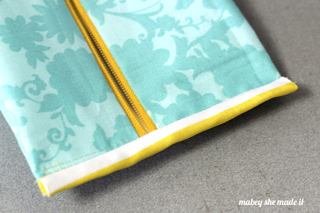 This amazing boxy zipper pouch holds a TON and has such cute detail on the ends. Tutorial shows you how to make one from Mabey She Made It.