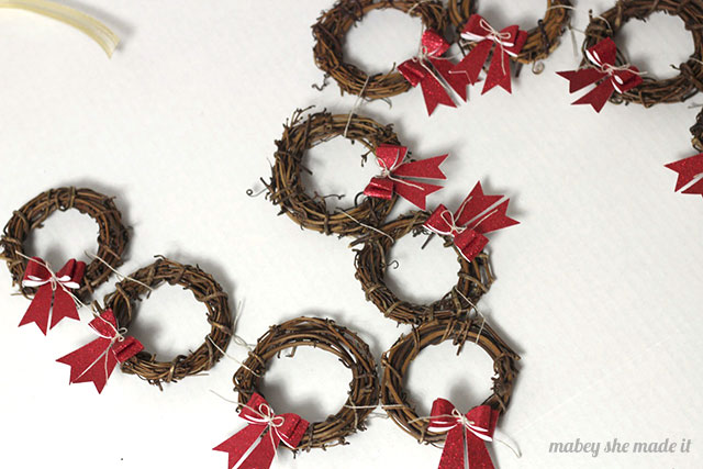 So cute and easy! These Mini Wreath Garlands are simple to make and perfect for your mantel.