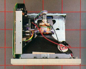 The top of the Mac with the cover removed. The disk drive and digital circuitry are below the cathode-ray tube; the analog circuitry is to its left