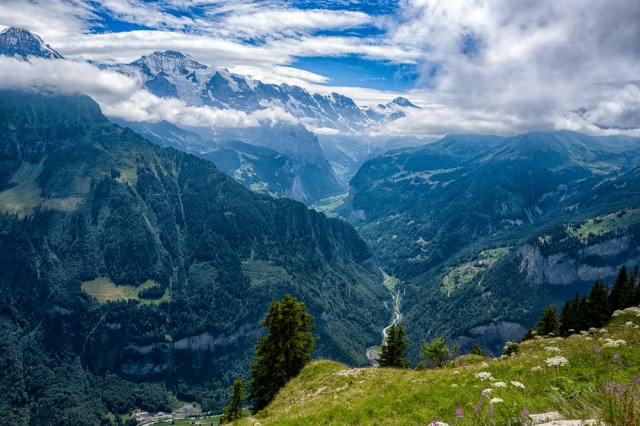 The impressive view of the Lauterbrunnen valley from the top of Schynige Platte where you can wander through the fantastic alpine garden. Wengen is just visible immediately underthe horizontal cloud formation over the valley