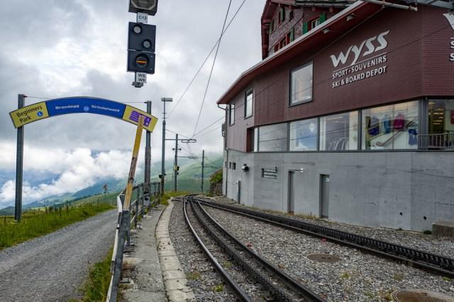 The onlyway isdown—the rack-and-pinionWAB line to Alpiglen, Brandeggand Grindelwald leaving Kleine Scheidegg station