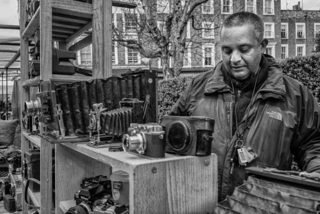 Juliano tending his well-stocked photographic stall (Photo Mike Evans, Leica M-P and 28mm Elmarit)