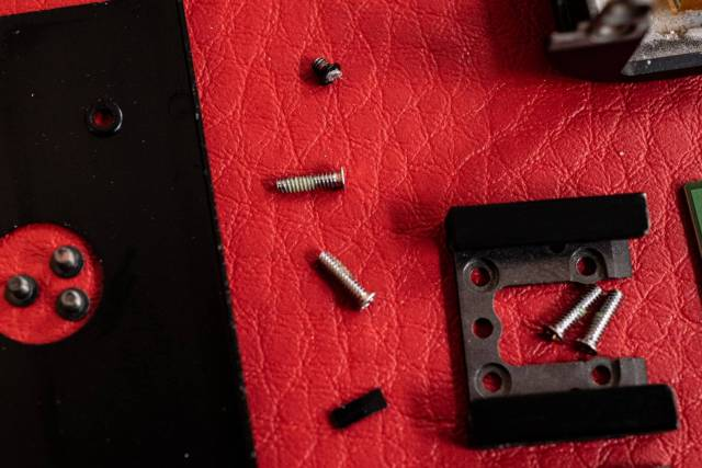 itsy bitsy screws need a magnifying loup and a magnetic screwdriver