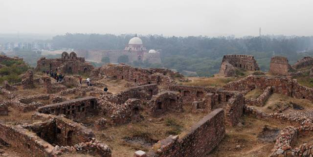 Ghiyasuddin Tughlaq's tomb in the distance seen from Tughlakabad Fort which lies in almost complete ruin in south Delhi. This one is a stitch of two photographs more to convey a sense of the scale of the place. Some of the sixty odd people in the group can be seen on the left.