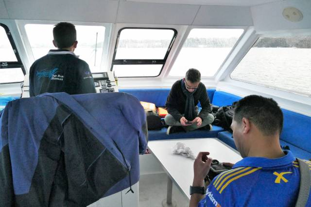 Inside the captain steered us back while photographers began downloading and editing