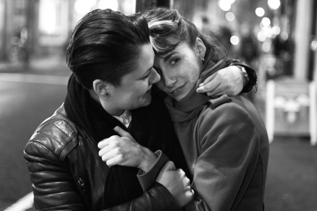 Night shot in Soho: Nichol and Lucy in Old Compton Street. Image Mike Evans, M9 Monochrome and 35mm Summilux FLE