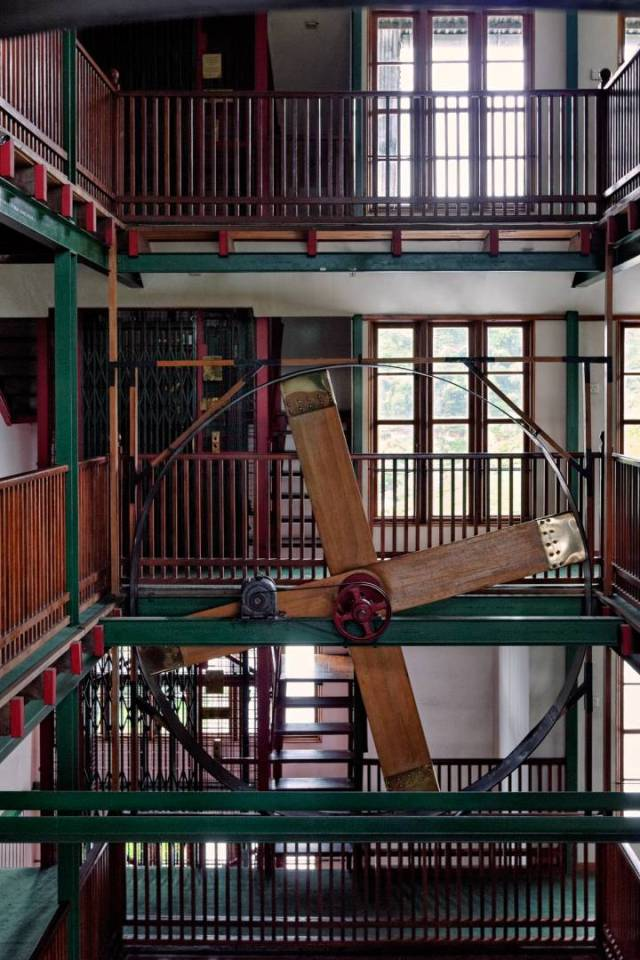 A giant fan in the stairwell that once dried tea leaves is turned on every day