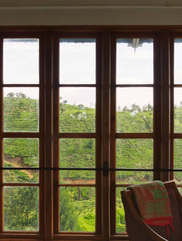 The original windows in the bedrooms afford a view of the surrounding tea gardens